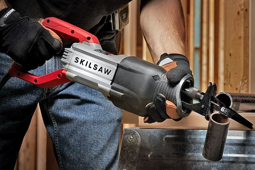 man working with reciprocating saw