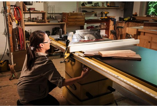 woman using cabinet table saw