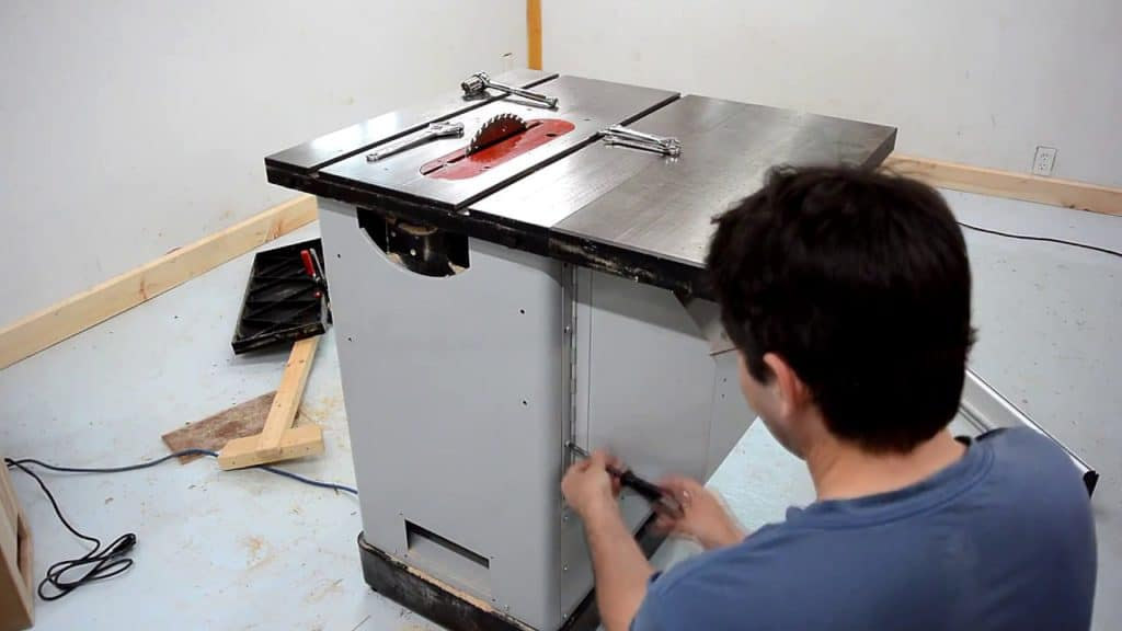 a person working on his delta hybrid table