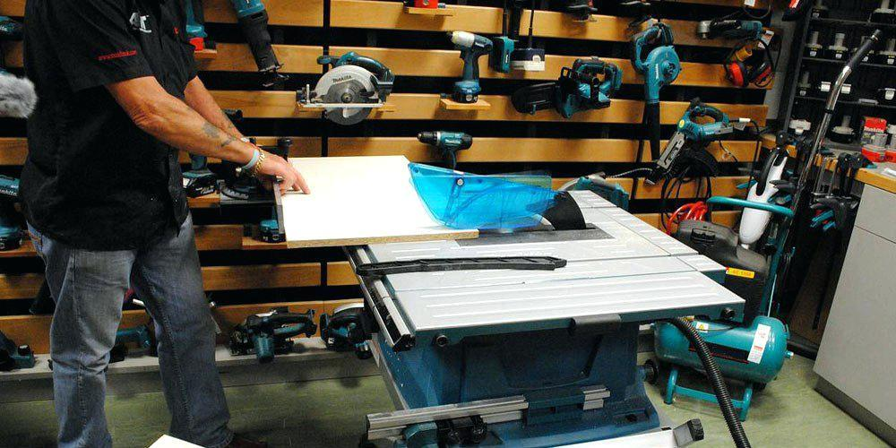 a person using contractor table saw